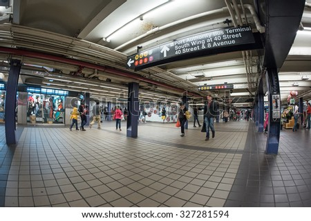 NEW YORK CITY - MAY 9, 2015: People walking inside subway station. The NYC Subway is one of the oldest and most extensive public transportation systems in the world, with 468 stations. - stock photo