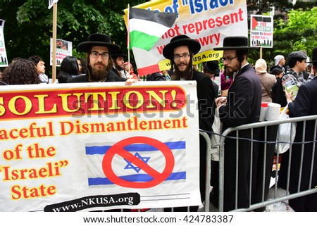NEW YORK CITY - MAY 15 2016: Several hundred activists marked Al Nakbah, the expulsion of the Palestinians & formation of Israel, with a rally & march across the Brooklyn Bridge. Neturei Karta