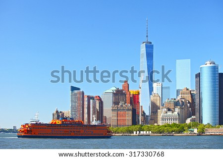 NEW YORK CITY-MAY 23 2015: Staten Island Ferry transporting commuters to Lower Manhattan financial district - stock photo