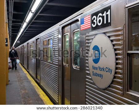 NEW YORK CITY - MAY 2015: Subway wagon on platform. The NYC Subway is one of the oldest and most extensive public transportation systems in the world, with 468 stations. - stock photo