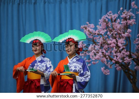 NEW YORK CITY - MAY 10 2015: the ninth annual Japan Day was observed in Central Park with demonstrations of swordsmanship, kabuki face painting, folk dances, Japanese foods, costumes & music - stock photo