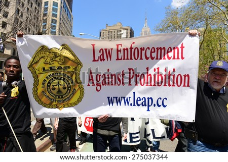 NEW YORK CITY - MAY 2 2015: the 17th annual cannabis parade made its way along Broadway to Union Square Park where activists encouraged legalization of marijuana. LEAP banner