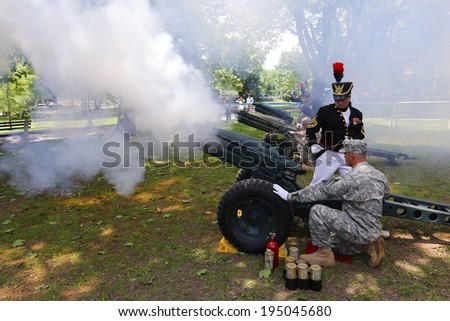 NEW YORK CITY - MAY 26 2014: The 146th annual King's County Memorial Day Parade, one of the nation's oldest, honored fallen & living veterans in the streets of Bay Ridge, Brooklyn. Cannon salute - stock photo
