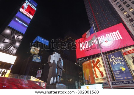 NEW YORK CITY - MAY 25: Times Square, featured with Broadway Theaters and animated LED signs, is a symbol of New York City and the United States, May 25, 2015 in Manhattan, New York City. - stock photo