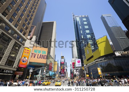 NEW YORK CITY - MAY 24: Times Square, featured with Broadway Theaters and animated LED signs, is a symbol of New York City and the United States, May 24, 2015 in Manhattan, New York City. - stock photo