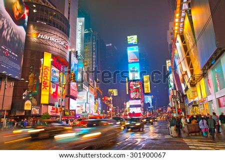 NEW YORK CITY-MAY 28, 2013:Times square in Manhattan.  New York City illuminated colorful  advertising on the buildings at night in the most famous tourist destination in USA