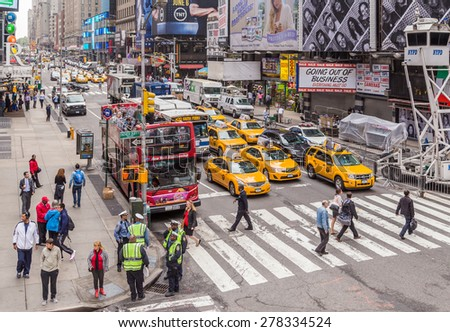 NEW YORK CITY - May 22, 2013: Times Square, is a busy tourist intersection of neon art and commerce and is an iconic street of New York City, May 23, 2013 in Manhattan, New York City, New York, USA - stock photo
