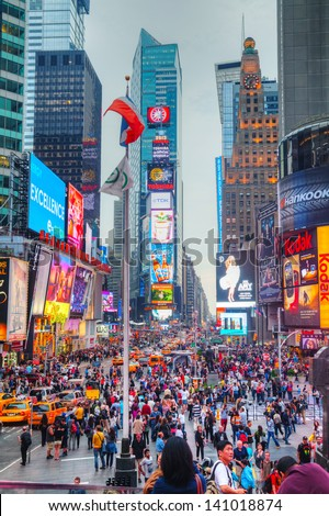 "NEW YORK CITY - MAY 12: Times Square on May 12, 2013 in New York City. Iconified as ""The Crossroads of the World"" it's the brightly illuminated hub of the Broadway Theater District. - stock photo"