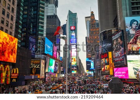 "NEW YORK CITY - MAY 11: Times Square with tourists on May 11, 2013. Iconified as ""The Crossroads of the World"" it's the brightly illuminated hub of the Broadway Theater District. - stock photo"