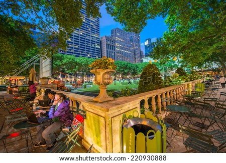 NEW YORK CITY - MAY 23, 2013: Tourists enjoy the quiet Bryant Park in the evening. is a 9.603-acre privately managed public park located in the New York City. - stock photo