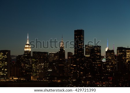 New York City Midtown Manhattan cityscape at night, USA. - stock photo