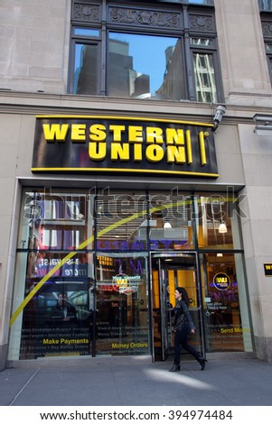 NEW YORK CITY - MONDAY, FEBRUARY 22, 2016: Pedestrians walk past a Western Union storefront. The Western Union Company is an American financial services and communications company - stock photo