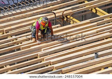 NEW YORK CITY, NEW YORK - APRIL 28, 2014: Construction worker at construction site near the High Line. Its popularity has led to dozens of new residential and commercial buildings along its route.
