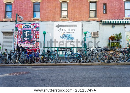 NEW YORK CITY, NEW YORK - NOV 10:  Bicycles are parked in front of subway entrace in Williamsburg in Brooklyn on November 10, 2014. Commuters often ride their bikes to subway stations around the city. - stock photo