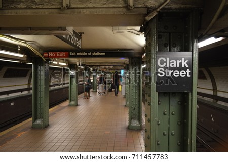 NEW YORK CITY, NEW YORK, UNITED STATE - JULY 8 2017 . The platform of Clark Street train station with some waiting passengers.