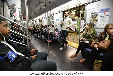 NEW YORK CITY - NOV 11: People ride subway train on Nov 11, 2015 in New York City, USA. The New York Subway has the most stations of any subway in the world at 469.