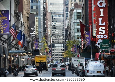 NEW YORK CITY - NOV 11: Traffic and people make their way along a busy downtown Manhattan street on Nov 11, 2015 in New York City, USA.   - stock photo
