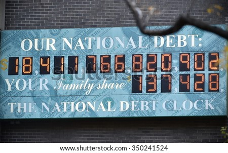 NEW YORK CITY - NOV 11: View of the National Debt Clock on a downtown Manhattan street on Nov 11, 2015 in New York City, USA. The clock shows gross national debt and each family's share of that debt. - stock photo