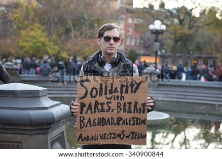 NEW YORK CITY - NOVEMBER 14 2015: A rally at Washington Square Park culminated in a candlelight vigil outside the French consulate for victims in Paris.  - stock photo