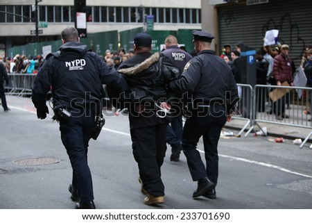 NEW YORK CITY - NOVEMBER 27 2014: Ferguson protesters attempted to block Macy's Thanksgiving Day parade in reaction to the grand jury's failure to indict Darren Wilson. NYPD made several arrests