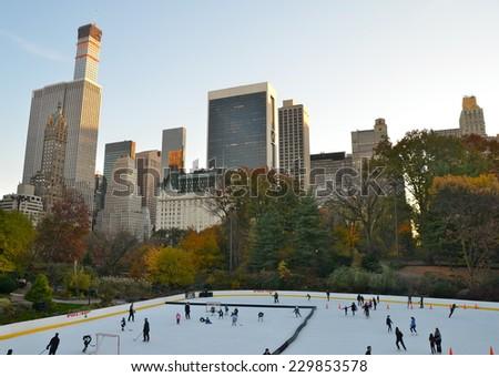 NEW YORK CITY - NOVEMBER 10, 2014: Ice-skating people in Central Park on November 10, 2014 in Manhattan, New York City, USA. - stock photo