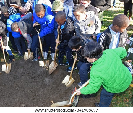 NEW YORK CITY - NOVEMBER 20 2015: Mayor de Blasio, former mayor Mike Bloomberg & Bette Midler celebrated the planting of one million new trees in NYC. PS 35 students with shovels