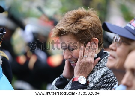 NEW YORK CITY - NOVEMBER 11 2015: New York City's Veterans Day parade was led by the US navy as this year's featured service. Commmissioner Loree Sutton reacts to 221 gun salute