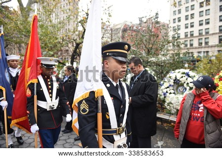 NEW YORK CITY - NOVEMBER 11 2015: New York City's Veterans Day parade was led by the US navy as this year's featured service. Flag honor guard marching