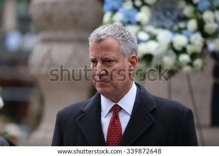 NEW YORK CITY - NOVEMBER 11 2015: New York City's Veterans Day was led by the US navy & grand marshal & world war two naval veteran Robert Morgenthau.Mayor de Blasio in front of Eternal Light Memorial - stock photo