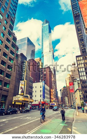 NEW YORK CITY - NOVEMBER 26: New York street, Broadway, in Midtown of Manhattan as seen on November 26, 2015, Thanksgiving Day, known as heart of American theatre industry. Instagram filtered look.