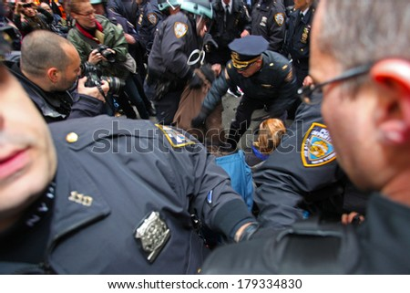 NEW YORK CITY - NOVEMBER 17 2011: Occupy Wall Street, a popular movement opposed to malfeasance on Wall Street, protested expulsion from Zuccotti Park with marches all over NYC. Swarming arrest - stock photo