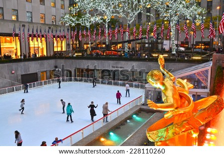 NEW YORK CITY - NOVEMBER 3, 2014: Rockefeller Center Ice skaters and tourists are all around the famous Rockefeller Center on November 3, 2014 in Manhattan, New York City, USA.. - stock photo