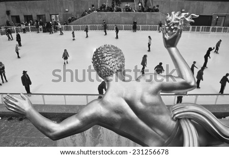 NEW YORK CITY - NOVEMBER 3, 2014: Rockefeller Center Ice skaters and tourists are all around the famous Rockefeller Center on November 3, 2014 in Manhattan, New York City, USA. - stock photo