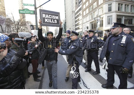 NEW YORK CITY - NOVEMBER 28 2014: several hundred activists gathered in Herald Square to urge passersby to boycott Black Friday sales at Macy's & other department stores in outrage over Mike Brown