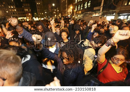 NEW YORK CITY - NOVEMBER 25 2014: several hundred gathered at Union Square to await announcement of the Ferguson grand jury's verdict in the death of Michael Brown followed by a march to Times Square - stock photo