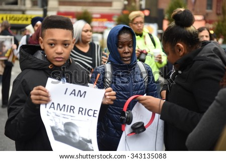 NEW YORK CITY - NOVEMBER 22 2015: Stop Mass Incarcerations Network sponsored a children's march on the one year anniversary of Tamir Rice's death at the hands of the Cleveland police. - stock photo