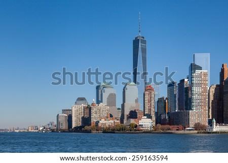 NEW YORK CITY, NOVEMBER 18:  The Lower Manhattan skyline in New York City pictured on November 18th, 2014.  The One World Trade Center dominates the skyline. - stock photo