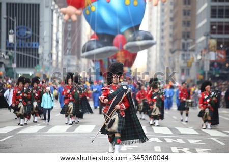 NEW YORK CITY - NOVEMBER 26 2015: The 89th annual Macy's Thanksgiving Day parade attracted hundreds of thousands of spectators in spite of threats of possible terrorist action. Drum major leads band - stock photo