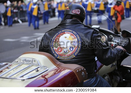 NEW YORK CITY - NOVEMBER 11 2014: the 95th annual Veteran's Day parade along Fifth Avenue is the largest Nov 11 celebration in the United States. Veterans based motorcycle club jacket & rider - stock photo