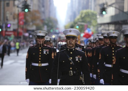 NEW YORK CITY - NOVEMBER 11 2014: the 95th annual Veteran's Day parade along Fifth Avenue is the largest Nov 11 celebration in the United States. US Marine Corps in formation - stock photo