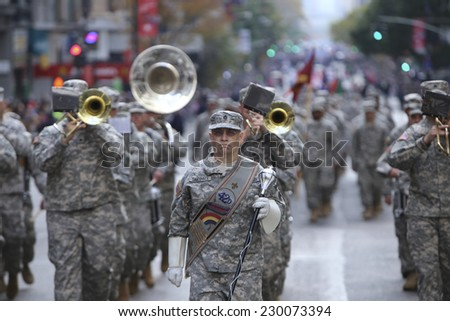 NEW YORK CITY - NOVEMBER 11 2014: the 95th annual Veteran's Day parade along Fifth Avenue is the largest Nov 11 celebration in the United States. - stock photo