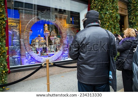 NEW YORK CITY - NOVEMBER 30, 2014:  View of festive Christmas holiday window display at landmark Fifth Avenue Lord & Taylor Department Store in midtown Manhattan. - stock photo