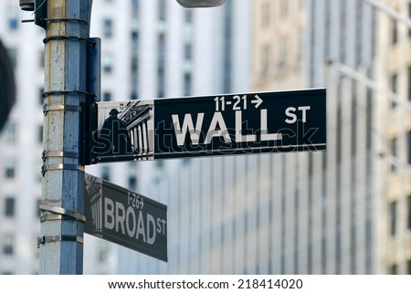 "NEW YORK CITY, NY - AUG 8: Wall Street is  a metonymy for the ""influential financial interests"" of the American financial industry. August 8, 2010 in Manhattan, New York City.  - stock photo"