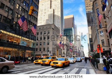 NEW YORK CITY, NY - DEC 30: Busy traffic on street on December 30, 2011 in New York City. Fifth Avenue has the world's most expensive retail spaces as the symbol of wealthy New York. - stock photo