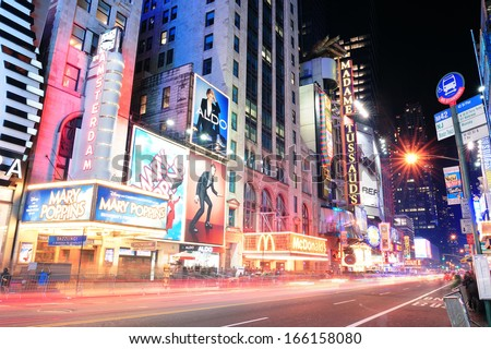 NEW YORK CITY, NY - DEC 12: 42nd Street with traffic and commercials on December  12, 2011 in New York City. 42nd Street is a major crosstown street known for its theaters and landmark architectures.