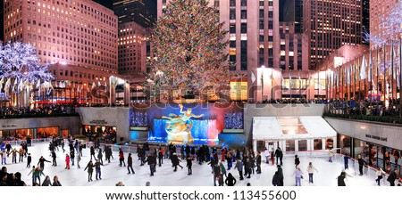 NEW YORK CITY, NY -DEC 30: Rockefeller Center skating rink at night on December 30, 2011, New York City. It was built by the Rockefeller family in 1939 and declared National Historic Landmark in 1987. - stock photo