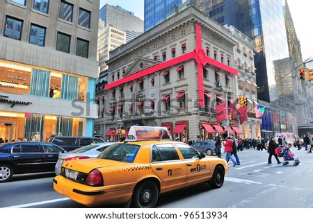 NEW YORK CITY, NY - DEC 30: Yellow taxi on Fifth Avenue on December 30, 2011 in New York City. With world class retail stores, it was ranked the world's most expensive retail spaces by Forbes in 1998 - stock photo