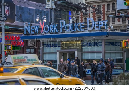 NEW YORK CITY, NY -Jan 9 2011: Times Square is featured with Broadway Theaters and LED signs as a symbol of New York City and the United States, January 9 2011 in Manhattan, New York City.  - stock photo