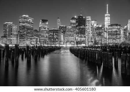 NEW YORK CITY, NY - JANUARY 4, 2016 - A scenic nightview of the skyscrapers of New York City from the Brooklyn Bridge Park.