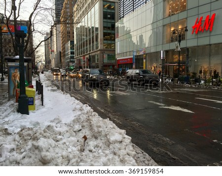 New York City, NY - January 26, 2016: Herald Square outside H&M store the morning after Blizzard Jonas as the morning commute returns to normal following delays and shut down of transit systems. - stock photo